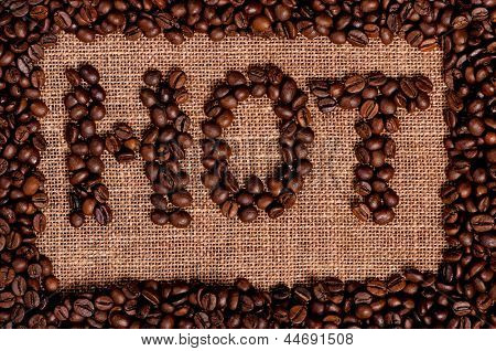 Word hot made from coffee beans on burlap
