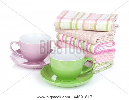 Two coffee cups and kitchen towels. Isolated on white background