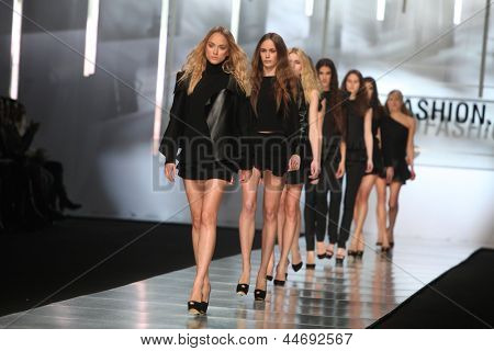 "ZAGREB, CROATIA - MARCH 14: Fashion model wears clothes made by Ivana Barac on ""PERWOLL FASHION.HR"" show on March 14, 2013 in Zagreb, Croatia."