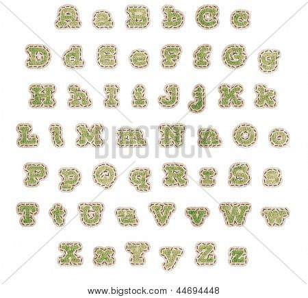 Upper and lower case alphabet in green fabric patches with brown stitching and beige outline with clipping path