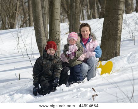 family in the winter forest