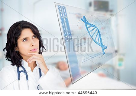 Doctor studying virtual screen showing DNA helix in hospital ward