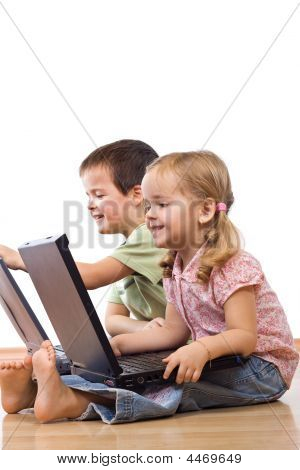 Kids Playing On Laptops