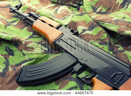 Russian assault rifle AK-47 on camouflage clothing
