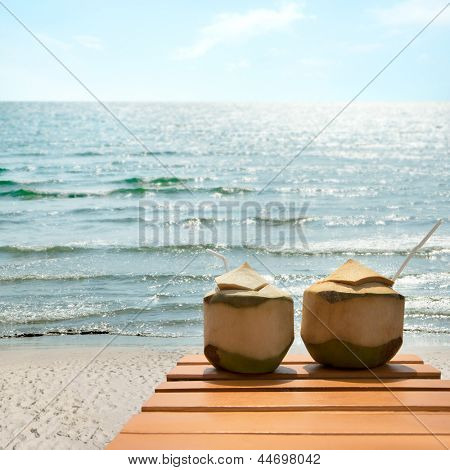 Romantic cocktail of coconuts on the beach