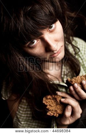 portrait of a poor beggar woman with bread
