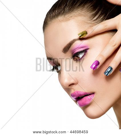 Fashion Beauty. Manicure and Make-up. Nail art. Beautiful Woman With Colorful Nails and Luxury Purple Makeup. Beautiful Girl Face and Hand