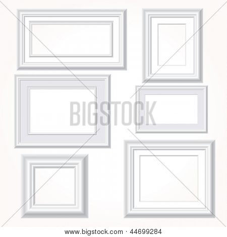 vector illustration of six empty white frames on white wall