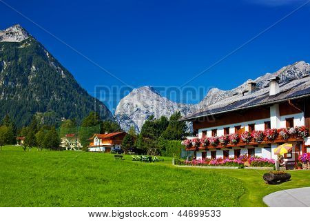 Traditional Alps village summer landscape.