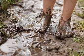 foto of wet feet  - Feet in mud close - JPG