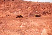 image of iron ore  - Mining truck working in iron ore mines Western Australia - JPG