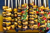 Grilled channeled applesnail in chili paste