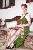 stock photo of autoharp  - Young Bavarian girl in traditional dress plays music on a zither - JPG