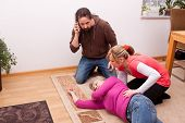 stock photo of resuscitation  - female senior is unconscious childs calling rescue service - JPG