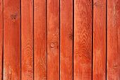 stock photo of log fence  - Part of vertical ancient wooden fence painted in red - JPG