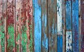 stock photo of gap  - Old fence background wood red and blue - JPG