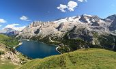 foto of italian alps  - summer view of mount Marmolada and Fedaia lake Trentino Italy - JPG