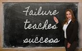 foto of proverb  - Successful beautiful and confident woman showing Failure teaches success on blackboard - JPG
