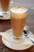 foto of latte coffee  - Caffe latte or coffee latte a coffee drink in tall glass coffee cups - JPG