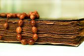 foto of prayer beads  - An ancient hand scripted Quran with prayer beads - JPG