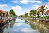 stock photo of population  - Jakarta old Town  along the Smelly river - JPG