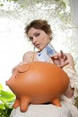 Old Costume Fashion Woman And Piggy Bank
