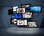 stock photo of mew  - Many screens showing business images under a spotlight on digital background - JPG