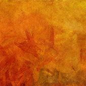 image of acrylic painting  - art abstract painted background with bright gold and red blots - JPG