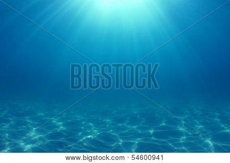 Underwater Background: Sunbeams in ocean