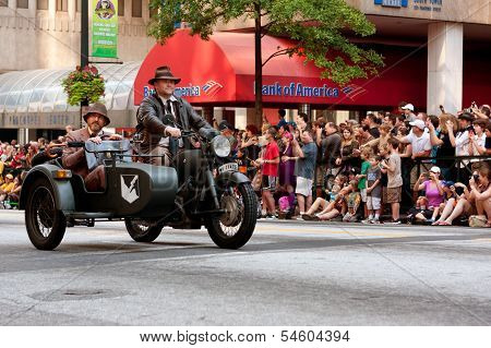 Indiana Jones Characters Ride Motorcycle In Atlanta Dragon Con Parade