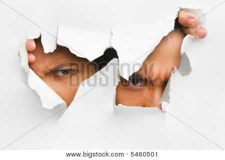 Two People Peeking From Hole In Wall