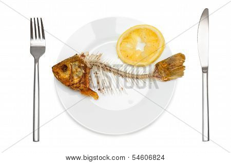 Fish Skeleton With Squeezed Lemon