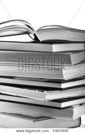 Open Book On Top Of Book Stack Isolated On White Background With Copy Space, Black And White