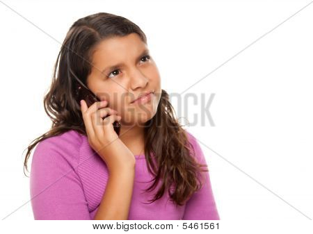 Frowning Hispanic Girl On Cell Phone