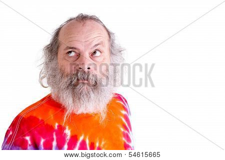 Baby Boomer With His Tie Dye T-shirt, Thoughtfully Looking Up Searching For Answers