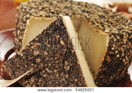 closeup of a handmade spice-coated cheese from Spain