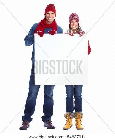 Happy couple with placard isolated over white background.
