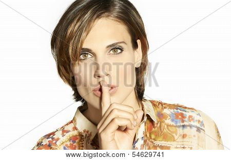 Beautiful Woman With Her Finger On Her Lips