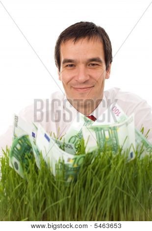 Confident Businessman With Green Banknotes In The Grass - Isolated