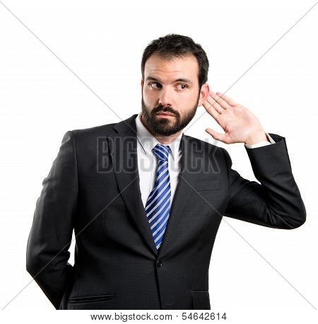 Young Business Man Hearing Something Over White Background