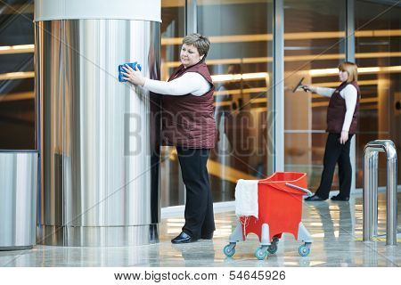 two woman cleaner worker in uniform cleaning indoor interior of business building