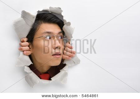 Man Looking Away To His Left Side From Hole In Wall