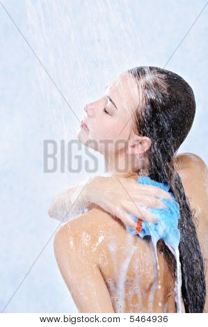 Woman Washing Her Body In A Shower