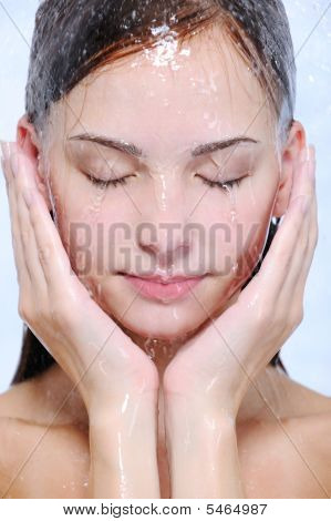 Streams Of Water On The Beautiful Female Face