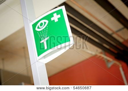 An image of a green laboratory eye sign