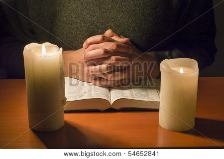 Praying To The Candlelight