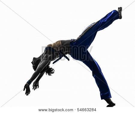 one caucasian woman capoiera dancer dancing in silhouette studio isolated on white background