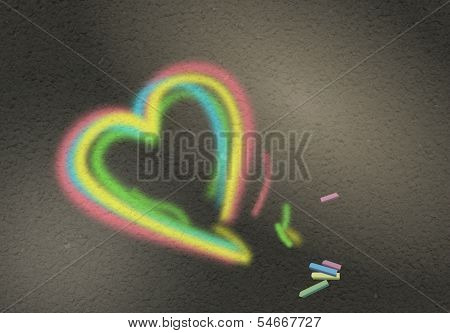 Colorful chalky heart symbol on road