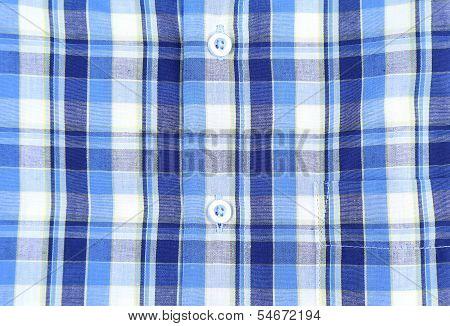 Plaid man shirt, button close-up background