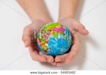 Kid Holding Little World Globe On Her Hands poster